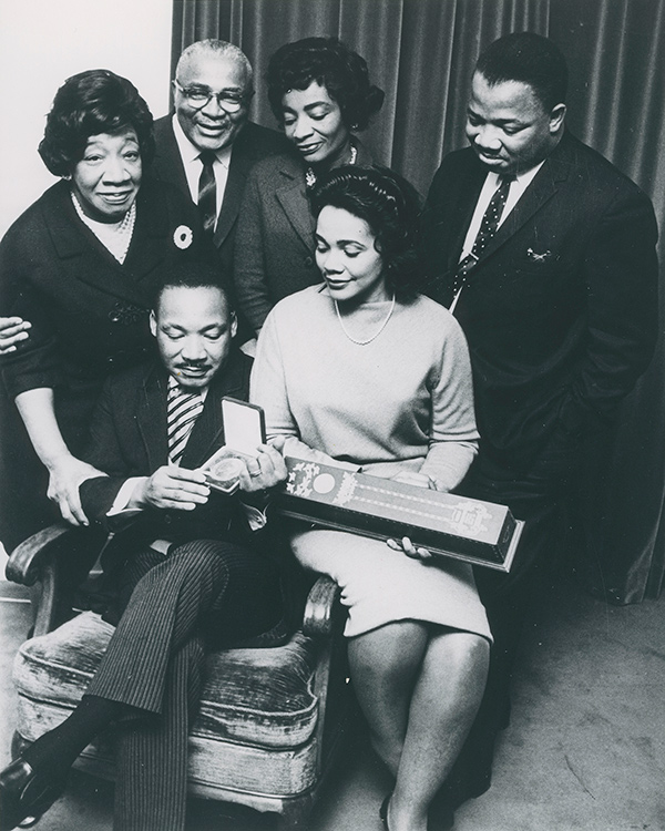 Moneta Sleet Jr., Martin Luther King Jr., surrounded by his family, holding the Nobel Peace Prize medal (1964). Photo courtesy Johnson Publishing Company